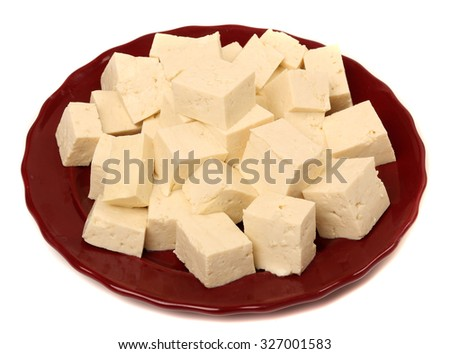 Tofu cubes on plate isolated on white background  - stock photo