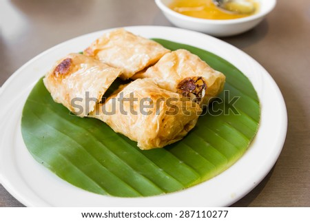 tofu curd roll on white plate - stock photo