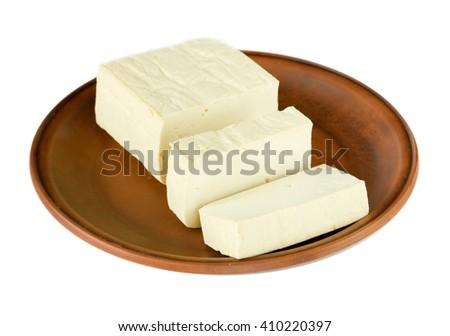 Tofu on plate isolated on white background - stock photo