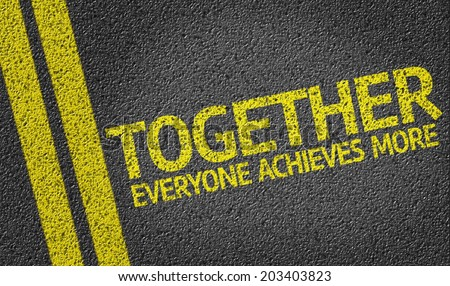 Together Everyone Achieves More written on the road - stock photo