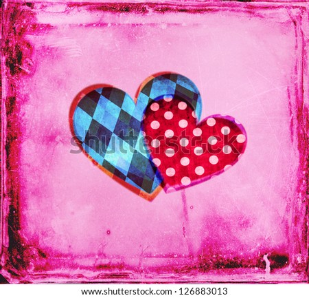 Together: two hearts -- a red one with polka dots, symbolizing a woman, and one with blue geometric patterns, a man -- on a pink aged background. Cheerful vintage. - stock photo