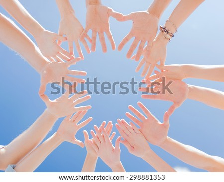 togetherness, team, union, people and gesture concept - close up of many hands over blue sky background - stock photo