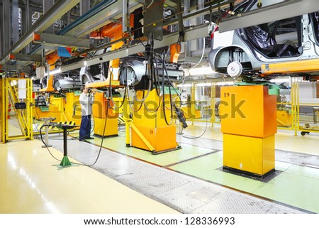 TOGLIATTI - SEPTEMBER 30: Area for car engine installation at factory VAZ on September 30, 2011 in Togliatti, Russia. AvtoVAZ production cars available in Australia, New Zealand, Canada and Germany. - stock photo