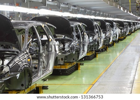"TOGLIATTI - SEPTEMBER 30: Row of new bodies for Lada Kalina at Avtovaz factory on September 30, 2011 in Togliatti, Russia. AvtoVAZ won contest ""Best Russian Exporter of 2011"" in category Cars. - stock photo"