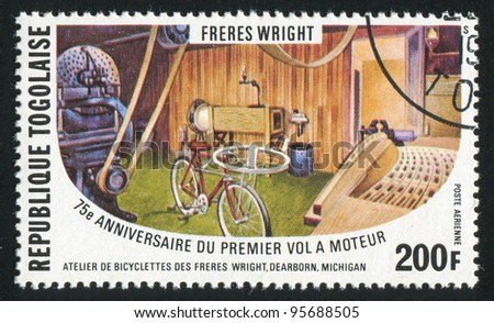 TOGO - CIRCA 1978: A stamp printed by Togo, shows Wrights' bicycle shop, circa 1978 - stock photo