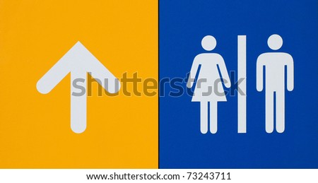 Toilet arrow pointing - stock photo