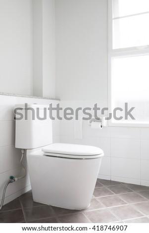 toilet bowl in white restroom. - stock photo