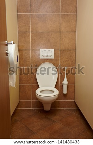Toilet closeup in a building interior - stock photo