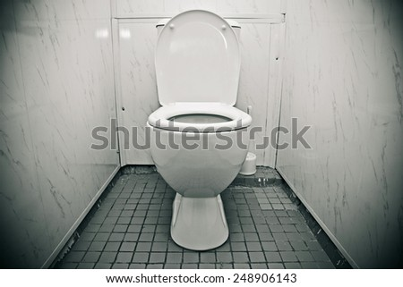 Toilet in the bathroom of economy class. Black-and-white photo - stock photo
