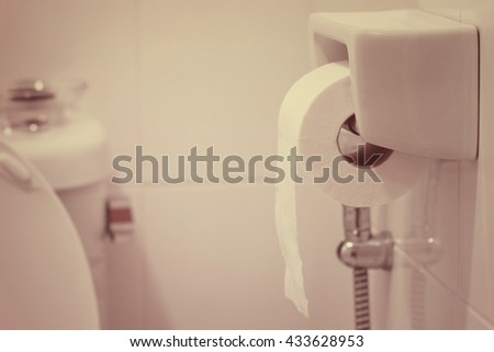 toilet paper in soft pastel color - stock photo