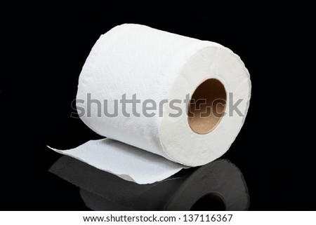 toilet paper isolated on black - stock photo