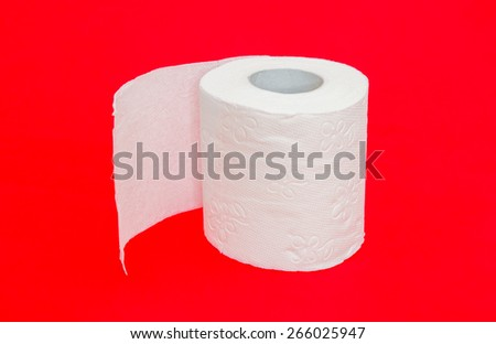 Toilet paper roll on red dangerous alerted important background suggesting diarrhea digestive and toilet problems and issues with a serious look in a very conceptual look. Concept - stock photo