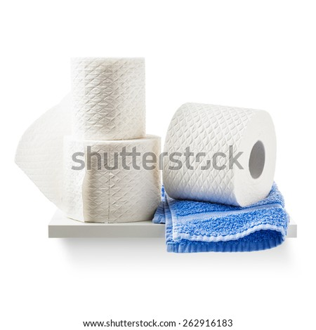 Toilet paper rolls and blue  towel on shelf isolated on white background. Bathroom cabinet. Objects group with clipping path - stock photo