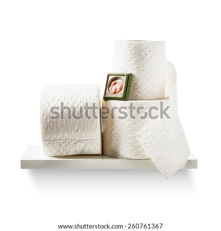 Toilet paper rolls on shelf isolated on white background. Bathroom cabinet. Object with clipping path - stock photo