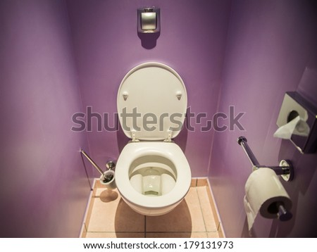 Toilet seat in modern room - stock photo
