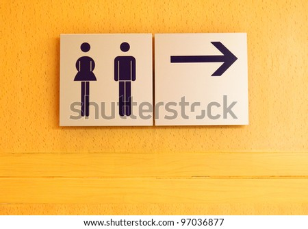 Toilet sign and direction on wood wall - stock photo