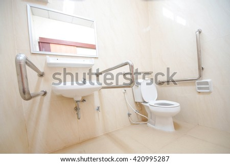 Toilet with friendly design for people with disability  - stock photo