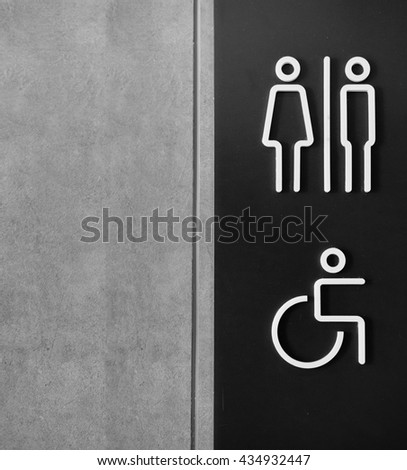 Toilets sign for public restroom with copy space - stock photo