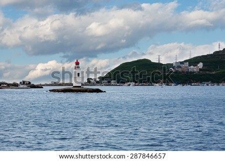 Tokarevskiy lighthouse - a historic landmark in Vladivostok, Russia. Lighthouse began working in 1910 and in June 2015 the lighthouse celebrated 105 years. - stock photo