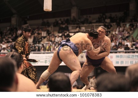 TOKYO - APRIL 7: Unidentified sumo wrestlers in a tournament on April 7, 2012 in Tokyo, Japan. Even though Sumo is Japan's national sport, most professional wrestlers are foreigners - stock photo