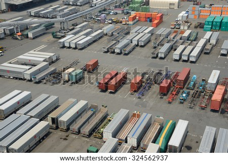 TOKYO - AUGUST 1, 2015: A trailer parking lot at Tokyo harbor. The Port of Tokyo is one of the largest ports in the Pacific Ocean with an annual traffic of 83 million tons of cargo. - stock photo