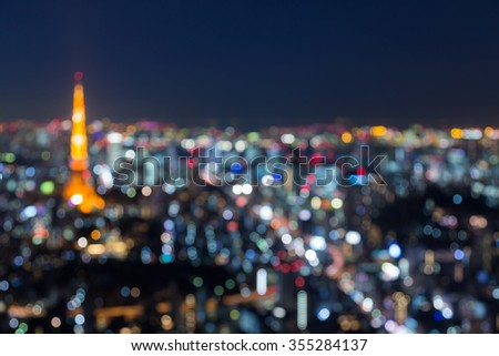 TOKYO - DECEMBER 9 : Blurred bokeh light, Tokyo tower and city aerial view twilight, on December 9, 2015 in Tokyo, Japan - stock photo