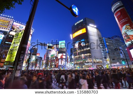 TOKYO - DECEMBER 24: Pedestrians at the famed crossing of Shibuya district December 24, 2012 in Tokyo, JP. Shibuya is a fashion center and nightlife area. - stock photo