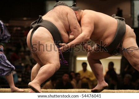 TOKYO - FEBRUARY 01: Close up of two sumo wrestlers in a tight grip during the Tokyo Grand Sumo Tournament, February 01, 2010 in Tokyo, Japan. - stock photo
