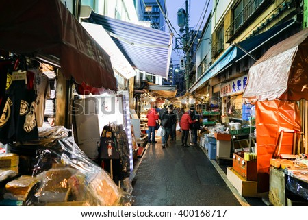 TOKYO- Jan 4: Workers at the Tsukiji Wholesale Seafood and Fish Market in Tokyo Japan on January 4, 2016. Tsukiji Market is the biggest wholesale fish and seafood market in the world. - stock photo