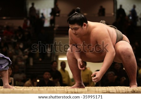 TOKYO - JANUARY 21: Asian sumo wrestler getting ready in the Tokyo Grand Sumo Tournament January 21, 2009 in Tokyo, Japan. - stock photo