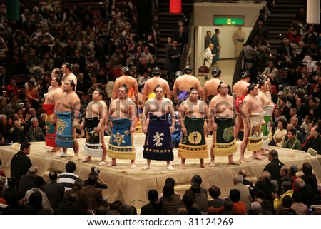 TOKYO - JANUARY 21: High rank sumo wrestlers line up for ceremony in the Tokyo Grand Sumo Tournament January 21, 2009 in Tokyo, Japan. - stock photo