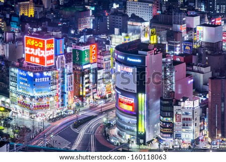 TOKYO - JANUARY 9:  Shinjuku nightlife district viewed from above January 9, 2013 in Tokyo, Japan. The district is a is a major commercial and administrative center. - stock photo