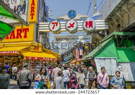 TOKYO,JAPAN - 27 April 2014 :Ameyoko is a busy market street along the Yamanote near Ueno Stations.various products such as clothes, fresh fish, dried food and spices are sold along here. - stock photo