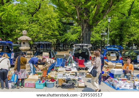 TOKYO,JAPAN - 24 April,2014: Flea market located at YAsukuni shrine . Yasukuni Shrine opens its grounds to antiques traders,pottery specialists in particular. on the third Sunday of every month.  - stock photo