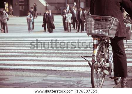 TOKYO, JAPAN - APRIL16: People ride bicycles on April 16, 2014 in Toyko, Japan. Cycling is one of most popular transport modes in tokyo city. - stock photo
