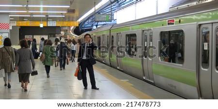 TOKYO JAPAN - APRIL 9 : Shinjuku station on April 9, 2014 in Tokyo, Japan. Shinjuku station is the biggest and busiest station in Tokyo. - stock photo