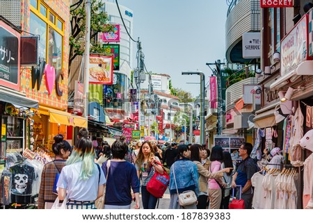 TOKYO, JAPAN - APRIL 17 2014: Takeshita Street(Takeshita Dori) in Harajuku. Takeshita Dori is considered a birthplace of Japan's fashion trends. - stock photo
