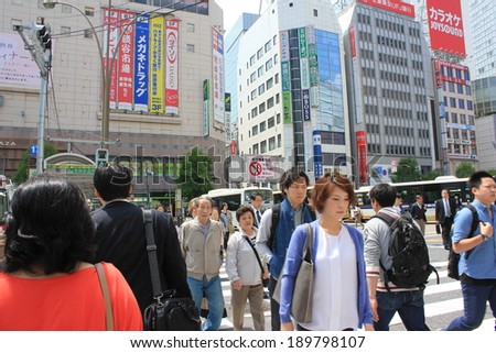 Tokyo, Japan - April 24, 2014 : Tourists and business people crossing the street at Harajiku - stock photo