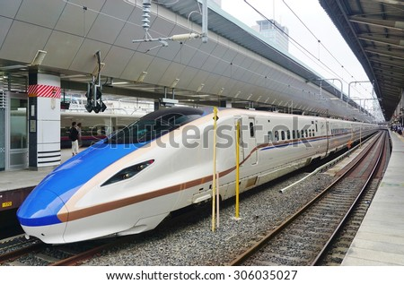 TOKYO, JAPAN -8 AUGUST 2015- A blue and white E7 Series Shinkansen high-speed bullet train operated by JR East at the Tokyo station. - stock photo