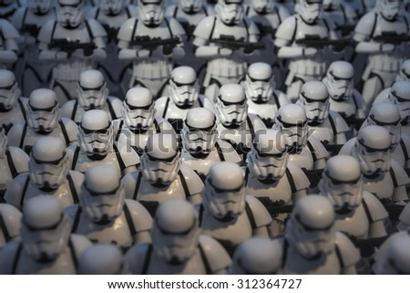 TOKYO, JAPAN - AUGUST An army of miniature model Stormtrooper figures lined up in a display illustrating the merchandise for the Starwars films shown on August 7, 2015 in Tokyo, Japan - stock photo