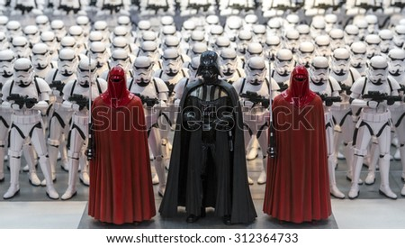 TOKYO, JAPAN - AUGUST Minature model figures of Darth Vader and storm troopers lined up in a display illustrating the merchandise related to the Starwars films shown on August 7, 2015 in Tokyo, Japan - stock photo