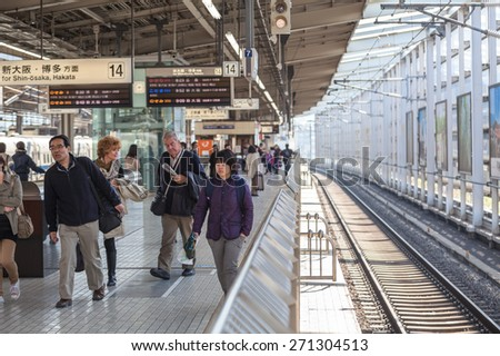 TOKYO, JAPAN - CIRCA APR, 2013: People walk on the Tokyo station platform. Empty railway. The Tokyo Station is a railway station in the Marunouchi district of Chiyoda - stock photo