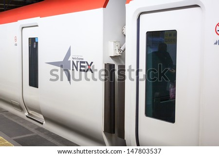 TOKYO, JAPAN - CIRCA APRIL, 2013: Narita Express (NEX) is a bullet train from Tokyo city to airport in Narita on circa April, 2013 in Tokyo, Japan.  - stock photo