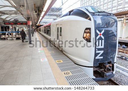 TOKYO, JAPAN - CIRCA APRIL, 2013: Narita Express train (NEX) is a transfer from Tokyo city to airport in Narita on circa April, 2013 in Tokyo, Japan. - stock photo
