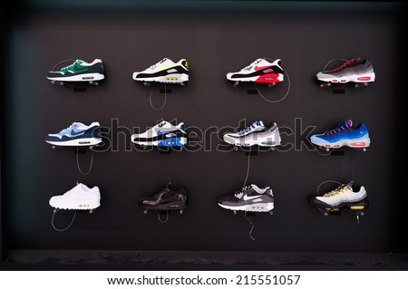 TOKYO, JAPAN - CIRCA August, 2014:  Nike brandded sneakers on display in Shibuya street. Shibuya street is a shopping center in Tokyo lined with brand names. - stock photo