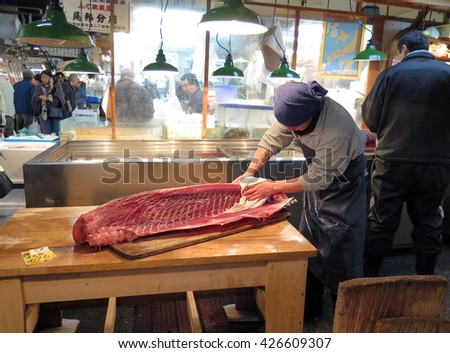 TOKYO, JAPAN - DECEMBER 12 : Fresh tuna shop in Tsukiji Market in Tokyo taken December 12, 2015. Tsukiji Market is the biggest wholesale food market in Japan. - stock photo