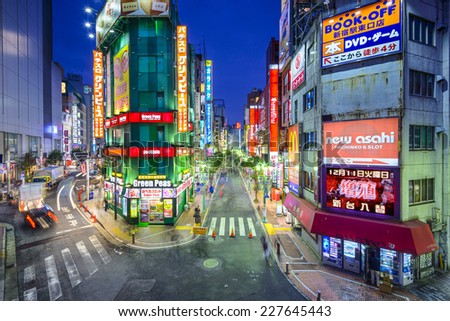 TOKYO, JAPAN - DECEMBER 17, 2012: Nightlife in the Shinjuku District. The area is a famed nightlife and red-light district. - stock photo