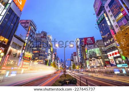 TOKYO, JAPAN - DECEMBER 15, 2012: Traffic passes through Shinjuku at Kabuki-cho. The area is a famed nightlife district. - stock photo