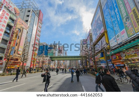 Tokyo, Japan - January 24, 2016: Akihabara district in Tokyo, Japan. Akihabara district is very crowded and closed for car traffic every Sunday, so pedestrians can walk freely. - stock photo
