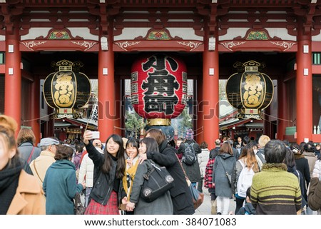 Tokyo; Japan -January  07: Large crowd including a group of young Japanese ladies taking a groufie  at the Hozomon Gate at Senso-ji Temple Asakusa, Tokyo. - stock photo
